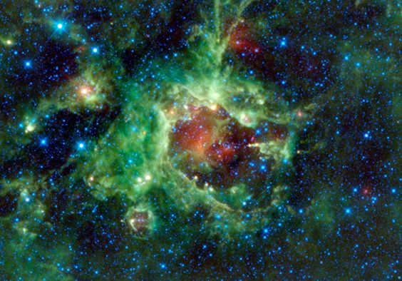 This is SH2-284, a star forming nebula. The image is false color, but each hue represents a different part of the infrared spectrum. Blue and teal is mostly coming from stars, while red and yellow is dust. Green comes from a very specific kind of material called a polycyclic aromatic hydrocarbons — long-chain carbon molecules which are essentially soot. PAHs are made in various ways, but are abundant where stars are being born, and that's what we're seeing here.