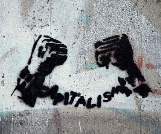 Capitalism- http://www.thesociologicalcinema.com/1/post/2011/09/taxes-or-spending-cuts-the-world-of-class-warfare.html]
