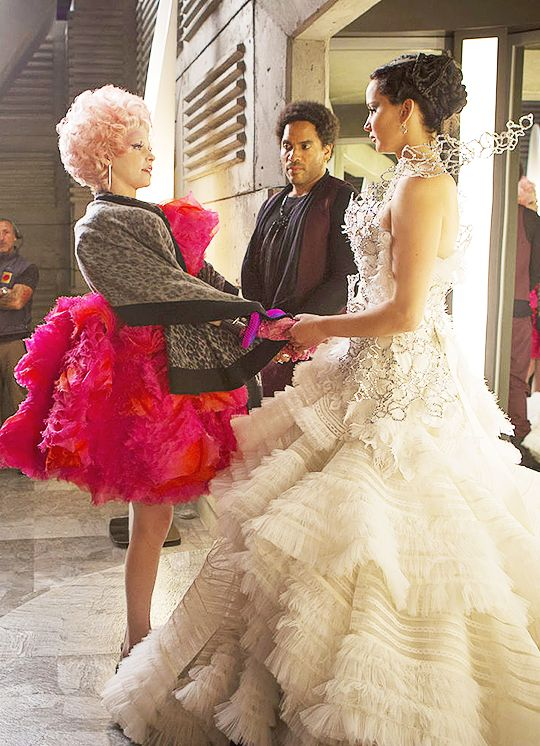 Jennifer Lawrence, Elizabeth Banks, and Lenny Kravitz rehearsing a scene on the set of The Hunger Games: Catching Fire (2012).