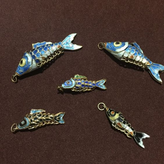 Amazing n Unique Fish Pendants !  Price Dropped Unique Fish Pendants (like big pieces are parents n little ones are 3 kids) !                              These are totally new pieces never seen before n the carving is amazing as the whole body moves like real ones !      I can guarantee u will love it !                 Won't last long so feel free to make a offer Must go ASAP n Will ship right away ! Jewelry