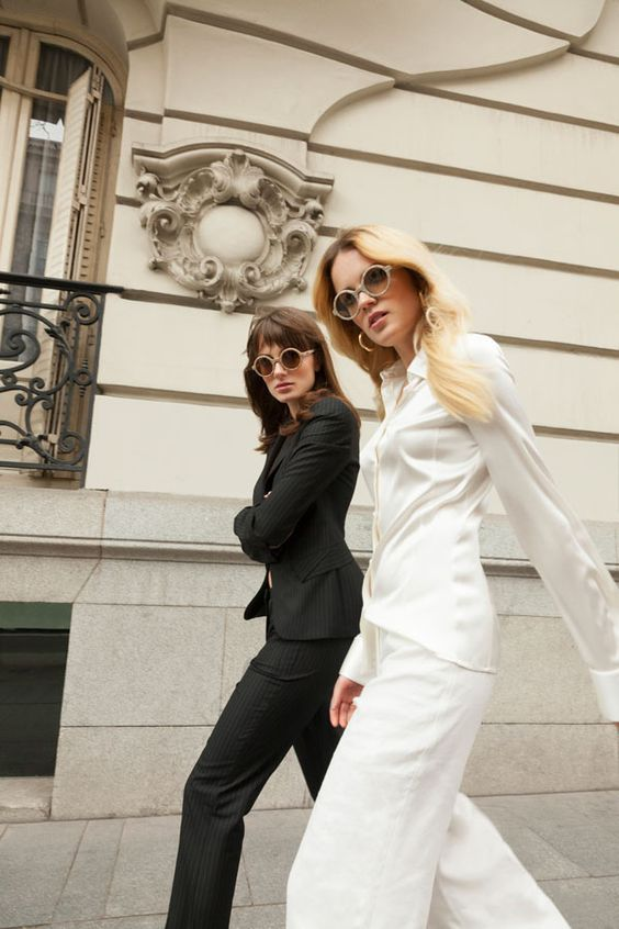 Twin sisters Miranda and Elektra Kilbey, aka Say Lou Lou, wearing head-to-toe Emporio #Armani