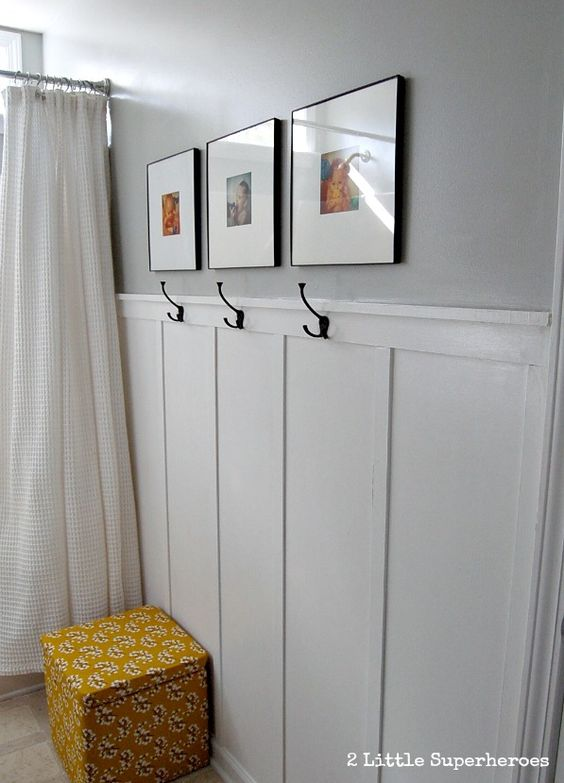 Example of budget DIY wainscoting in the bathroom  Also a good example of towel hooks for while one is in the shower  Hang while bathing for easy access. A great builder grade bathroom makeover  She did this all for