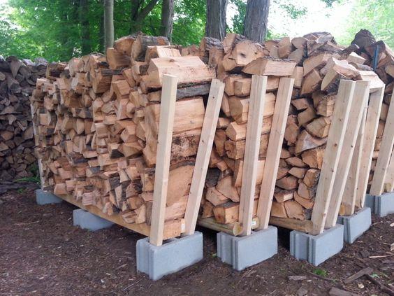 Easy DIY wood storage. Cinder blocks and 2x4's.