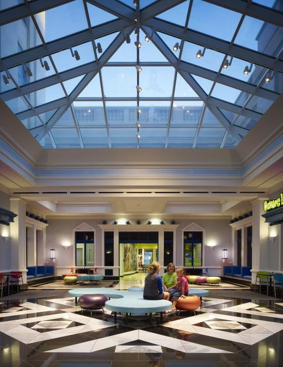 Inside cook children s medical center s new north tower a large skylight allows natural light - Skylight house plans natural light ...