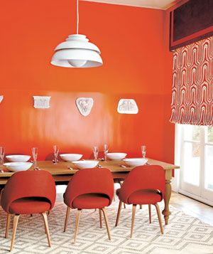 Make a bold statement with orange paint on your walls. It has an energy similar to red walls, but with a bit friendlier feel. Would you paint a room orange?