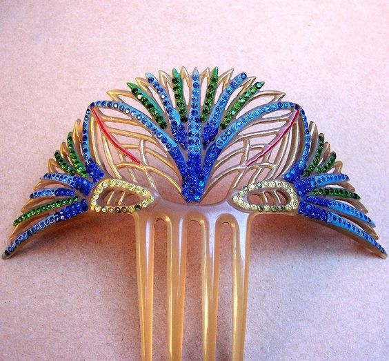 Egyptian hair comb | Art Deco period papyrus flower design hair comb in the Egyptian Revival style.