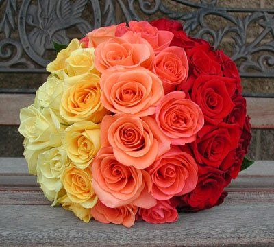 I love zebra but rainbow seems prettier for the wedding. :  wedding blue green inspiration orange pink purple reception red yellow Ombre Rose Bouquet