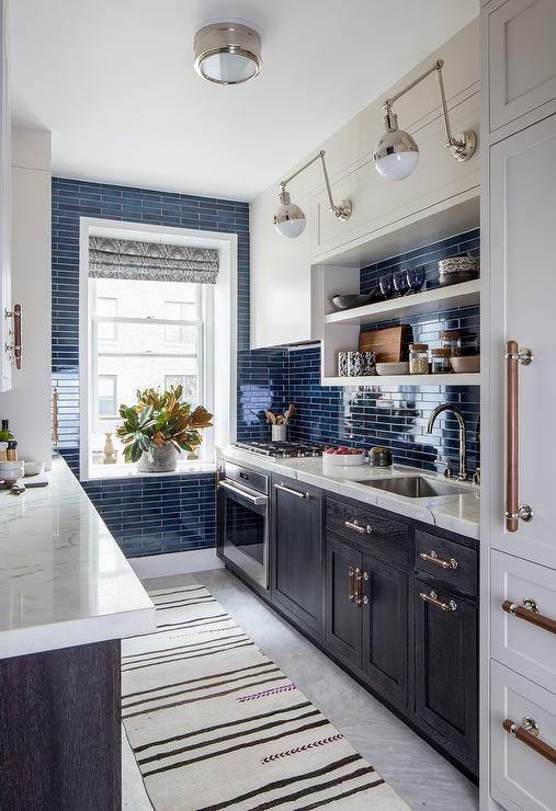 Black White And Blue Galley Style Kitchen Features An Ivory And Black Runner Placed Between Facing Black Oak Bold Kitchen Galley Style Kitchen Classy Kitchen
