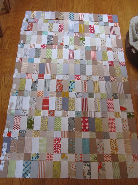 I like the use of rectangles and squares for the sashing and minimal use of white fabric.  I can't seem to get my blocks even with each other when the sashing is one piece.