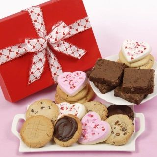 """Our most wonderful bakery confections combined in one box for a delicious Valentine surprise!  Sixteen """"made from scratch"""" assorted gourmet cookies including butter-cream iced hearts and four scrumptious chocolate chunk brownies will be sure to please.  Cookie assortment includes: chocolate chip, oatmeal raisin, sugar, peanut butter, M&M, white chocolate chip pecan"""