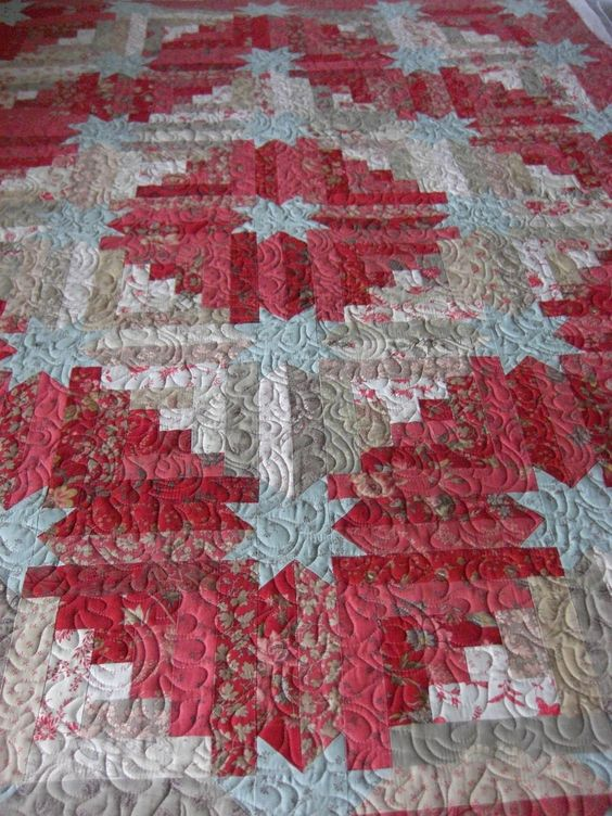 Quilting Square One: it is a traditional star log cabin pieced with all 3 lines of Moda French General...she quilted it using Rainbow Flight by Miki and Diane