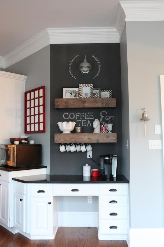 Turn the kitchen desk into a coffee bar. Then there's enough room to open the top of the coffee maker, and the paper clutter is moved somewhere else.