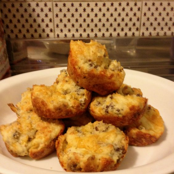 Sausage and Cheese Muffins  3 cups Bisquick 1 pound sausage 1 1/2 cups cheddar cheese 1 10oz can of Campbell's Cheddar Cheese Soup 3/4 cup water  Preheat oven to 375  Cook sausage until done, drain off the grease and let it cool  Mix Bisquick, cheddar cheese, and sausage together.   Mix water and cheddar cheese soup together.  Combine dry ingredients with wet ingredients until doughy.  Scoop mixture into muffin pan and cook for 20 to 25 mins.  Makes 24 muffins.