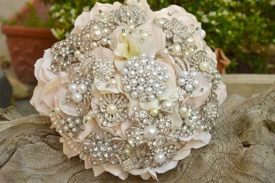 brooch bouquet mixed with ivory and cream roses. Join us on Facebook for more wedding inspiration!  The Bridal Rooms, Torquay, Devon https://www.facebook.com/BridalRooms