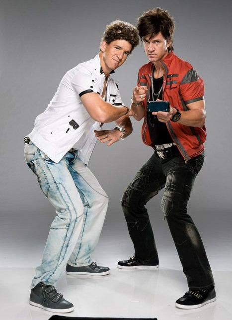 """Eli Manning and Peyton Manning in their hilarious rap video """"Football on Your Phone"""". Click through to watch the music video and read more!"""