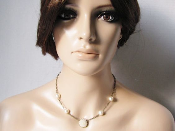Swarovski pearl necklace--very simple and pretty with a center flower--sometimes easier and cuter to wear with an outfit than a full strand of pearls.