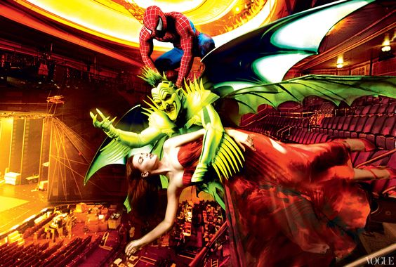 Spider-Man tries to save Mary Jane from the Green Goblin.  Vogue, December 2010