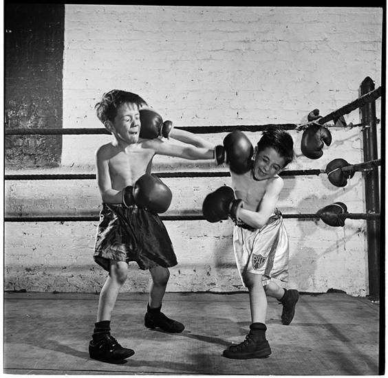 Boxing [at the] Police Athletic League [Two boys boxing.]