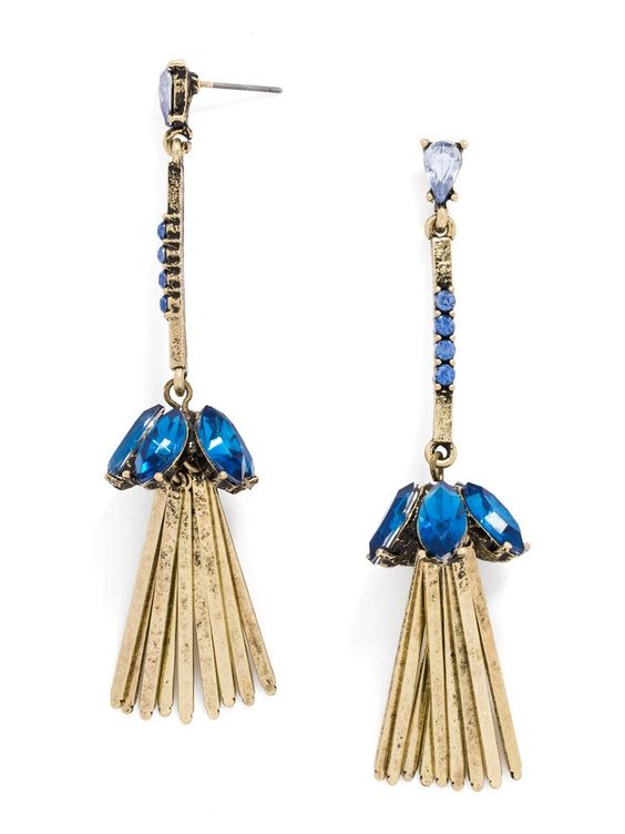 These glitzy gold shoulder dusters are embellished with gemstones for a long, fluid statement.