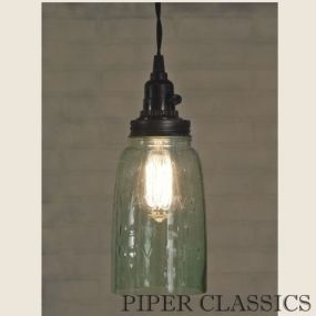 """Mason Jar Pendant Light with black lid includes a Half Gallon mason jar with no bottom.  The open bottom and ventilated top provides plenty of light while keeping everything cool.  4½"""" diameter and 11¼"""" tall. Shown with our 40 watt vintage bulb."""