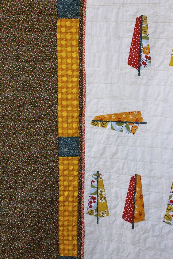 I like this variation of Anna Maria Horner's Feather Quilt