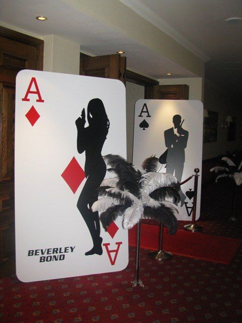 Casino prop big cutout cards could be cool props to hide for 007 decoration ideas