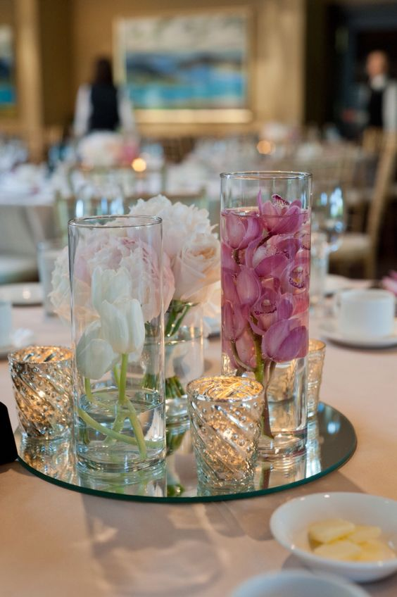 Centre piece: flowers and decor by @CailynDelovely  day coordinated by @filosophi reception and ceremony @weddingsatsgcc