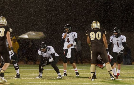 (Trent Nelson  |  The Salt Lake Tribune)  Northridge's Nate Kusuda approaches the line in the rain for a receiver as Davis hosts Northridge High School football Friday October 12, 2012 in Kaysville, Utah.