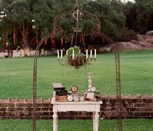 cute idea. love the moss covered candle chandelier at alter.: Ceremony Decoration, Vintage Weddings, Wedding Ideas, Wedding Ceremony Backdrop, Ceremony Ideas, Iron Arch, Garden Arbor