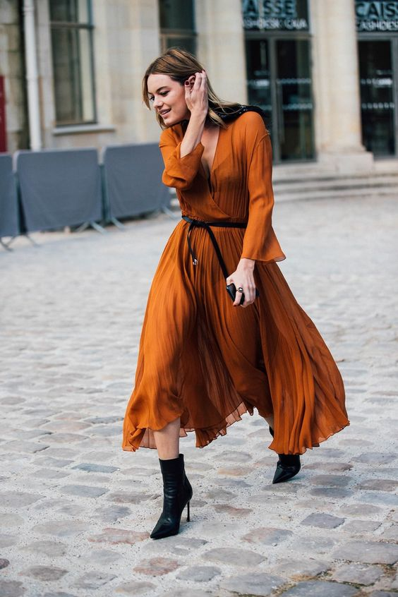 Flowing burnt orange pleated street style dress, worn with waist black leather belt and black ankle boots.