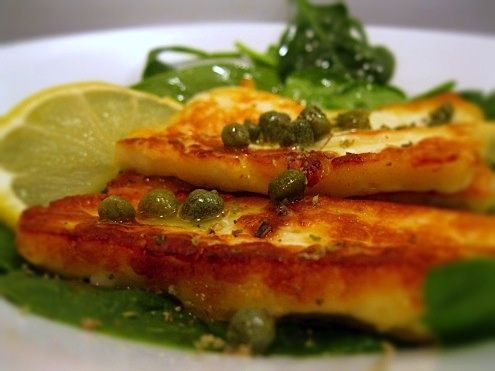 Fried Halloumi Cheese with Lemon and Caper Vinaigrette - A delectable appetizer featuring salty, fried halloumi cheese with a citrus and caper vinaigrette. By Kara and Marni Powers