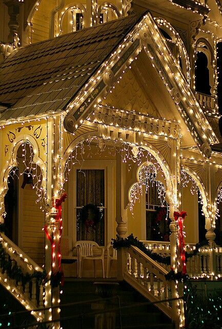 Christmas lights...looks like a gingerbread house! Plus I want a porch like that, except bigger someday :)