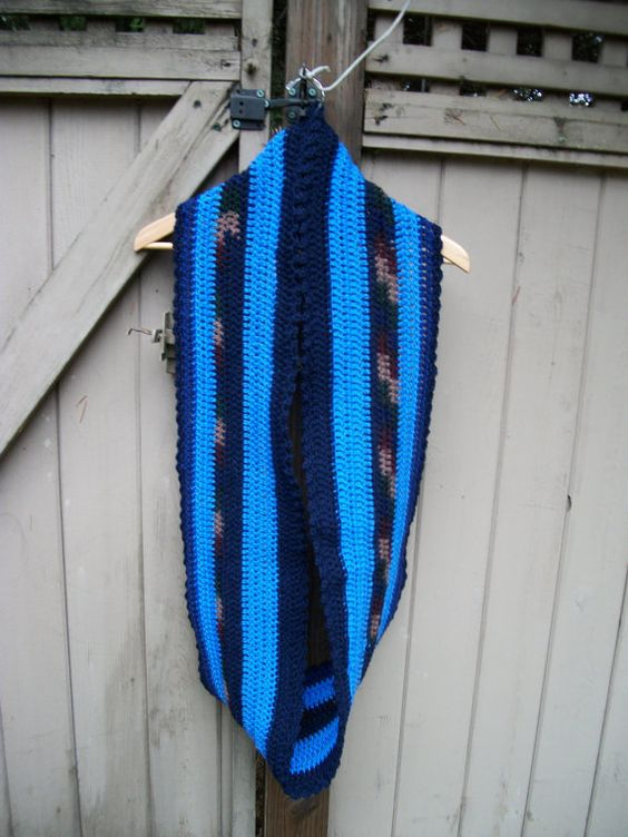 This is a scarf crocheted in acrylic yarn in a smoke and pet free home. The colors are bright and unique. No one else will have this beauty! I try to