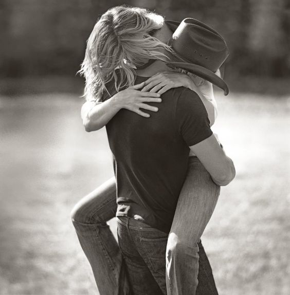 Tim McGraw and Faith Hill... Quite possibly one of the most beautiful couples i have ever seen!!!!!