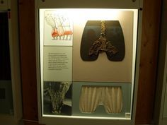 """Display on Viking Pumphosen (""""Rus"""" pants) at the Wikinger Museum Haithabu. The fabric fragments (crotch) have a wrinkled, crepe-like texture  -- the display suggests that this was done by using particularly high-twist yarn during the weaving process and then dipping it in hot water, causing the fabric to shrink and wrinkle."""
