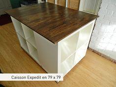 Accoler des meubles Ikea (en ajoutant des portes quand même, bois ou verre et ajouter un plateau en bois dessus (ikea en fait également) pour un îlot de cuisine peu cher