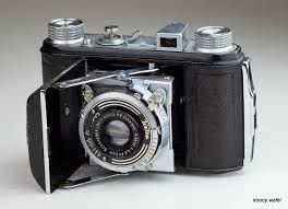 Image result for antique spy camera  ]