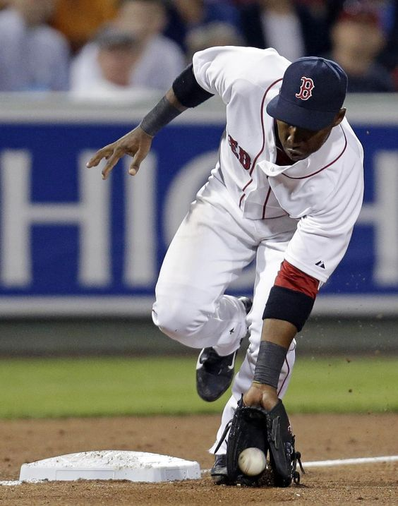 Boston Red Sox second baseman Jonathan Herrera fields a ground out by New York Yankees Francisco Cervelli in the sixth inning of an exhibition baseball game in Fort Myers, Fla., Thursday, March 20, 2014. The Yankees won 3-2. (AP Photo/Gerald Herbert)