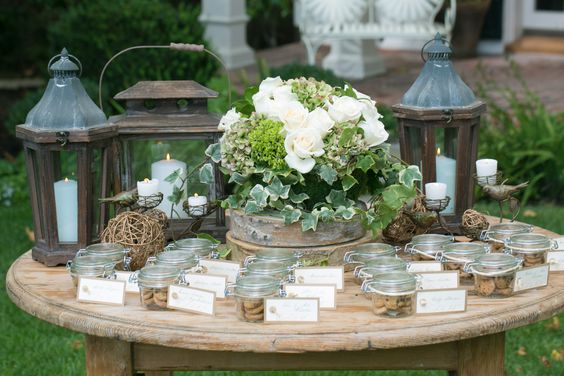Dress up your escort card table with florals and candles.