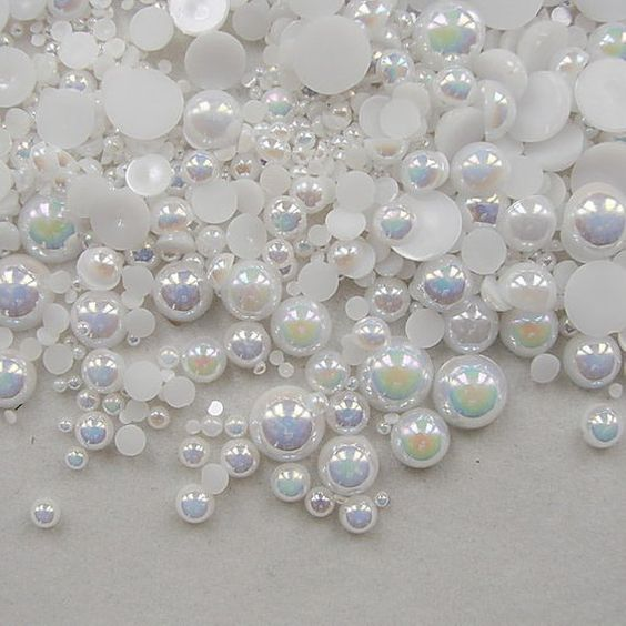 pearly ivory coloured 50 x acrylic oval beads 6mm x 3mm
