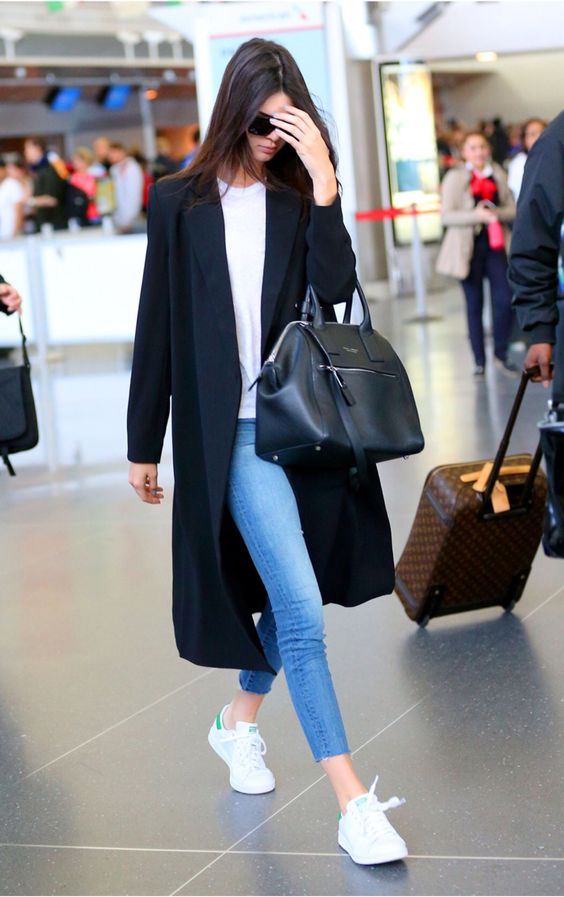 We love Kendall Jenner's simple outfit for heading to the airport! Check out www.travelfashiongirl.com for more suggestions on traveling in style.:
