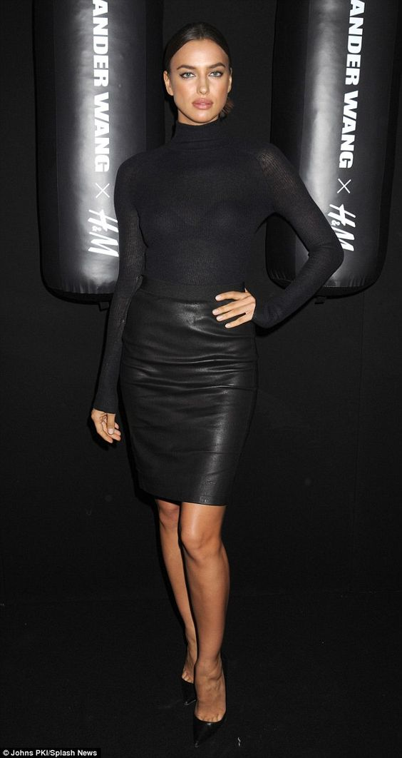 Irina Shayk, classic and flawless at the  Alexander Wang H&M Collection launch in a long sleeved black rollback jumper tucked into a leather pencil skirt and finished with patent pointed toe stiletto pumps...x