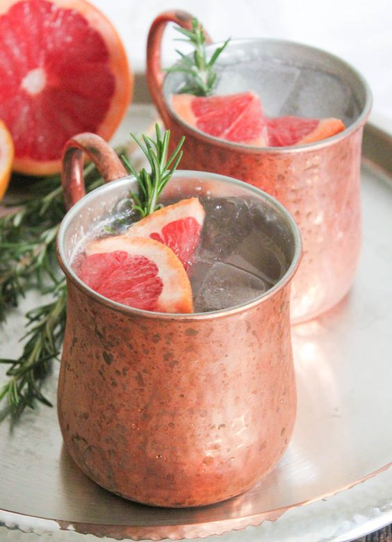 {Oh now these are a fun new twist to Christmas morning!} via Domesticate Me: Grapefruit-Rosemary Mule