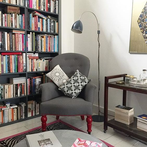 This is one of my favourite spots in the house. There's something so comforting about being surrounded by books. It's where I sit when I have to work but don't feel like the discipline of my desk. It's the working by stealth seat. Do you have one of those? . . . #cornerofmyhome #books #readingnook #library #myhome #madaboutthehouse #rugs #vintage #floorlight #instadaily #victorianhouse