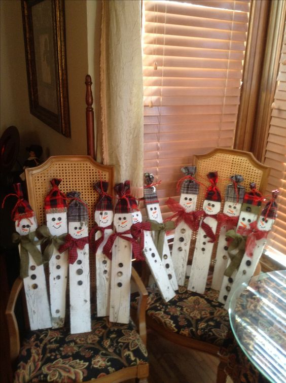 Snowmen made out of old picket fences