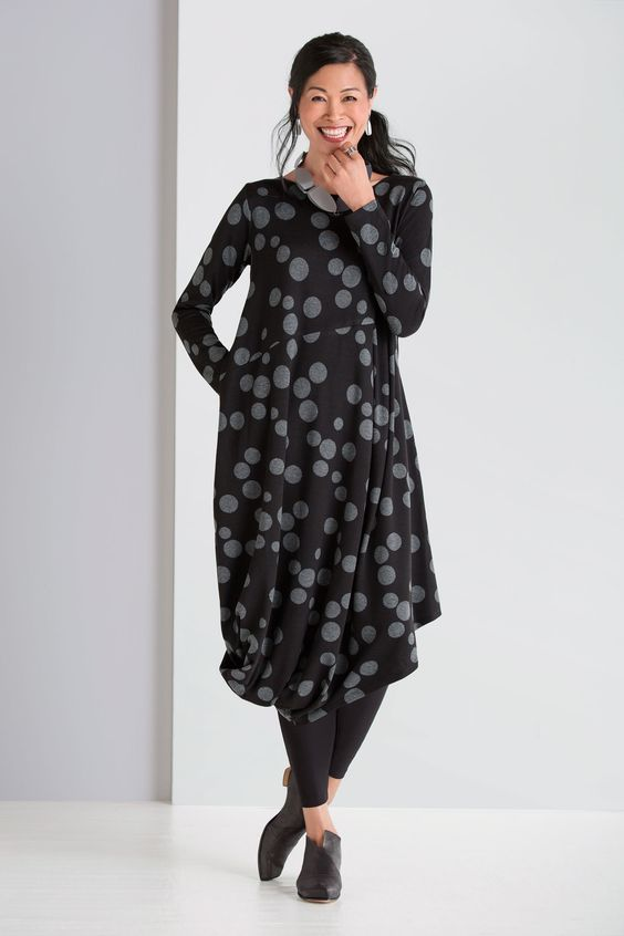 Scallop Dress by Spirithouse. Fun, cozy, and eye-catching, this perfect fall dress is enlivened by playful polka dots and a dramatic sweep of fabric that drapes to one side of the angled hem.: