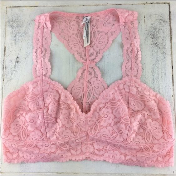 """[Free People] Galloon Lace Racerback Crop Bralette Racerback bralette top features scalloped edges throughout. Stretch floral lace construction with a stretch mesh lining. Single cup seam shapes the wireless cup. Underbust band offers light support. Slip on design.   Color: Blush Fabric: 90% Nylon 10% Spandex Size: Large Band Length: 14"""" Condition: NWT!  No Trades! No PayPal! Free People Intimates & Sleepwear Bras"""