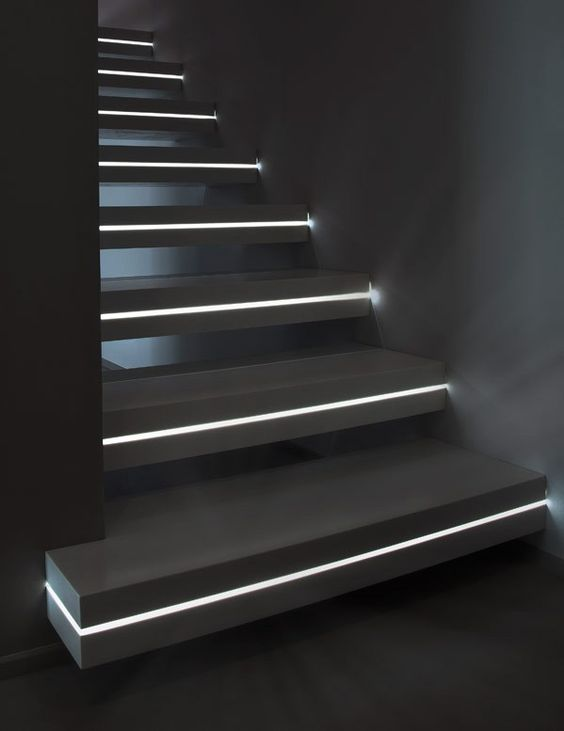 Adding led light strips within the stairs would create an amazing lighting effect at night that you wouldn't notice during the daytime when you don't need it. If I set up a sensor with a timer it would only come on during a certain time of day and if i walk by. Super efficient. design that would look great: