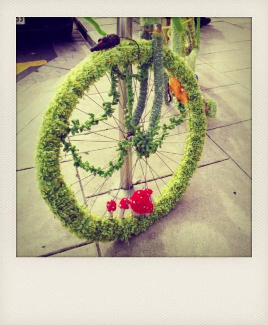 yarn bombed bike wheel