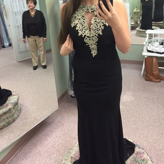 BRAND NEW Prom Dress This black and silver/gold embellished prom dress has only been worn in the one picture you see above. The boutique I bought this from doesn't do returns so I need to sell it on here ASAP! Make offers and ask any questions you have! Also available on Ⓜ️ for $400 with free shipping! La Femme Dresses Prom